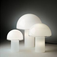 Originally designed in 1978 by Luciano Vistosi for Artemide, the contemporary opaline form of the Onfale Table Lamp has become a century lighting design classic.Crafted almost entirely from blown opaline glass, the Onfale Table Lamp features a transp Verre Design, Luminaire Design, Desk Light, Light Table, Blitz Design, Luminaire Vintage, Kitchen Lamps, White Table Lamp, Table Lamps