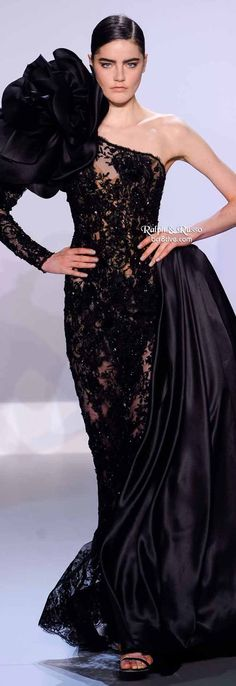 Ralph & Russo Spring 2014 HC   Black embellished French Chantilly lace one shoulder gown with silk gazar flower and organza side bustle