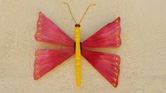 The butterflies are made from single ceiling fan blades.  They are becoming more popular than the dragonflies now.  ;)