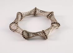Bracelet |  Designer unknown.  Modernist bracelet with flexible sterling wires that attach, with a twist, to copper rings.