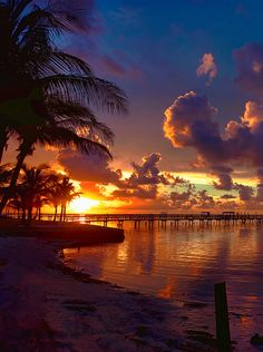 sunset over the pier, this looks like the beach at Domincan Republic...beautiful...