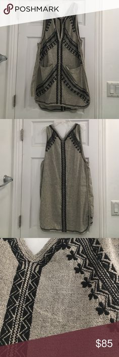 Free People Black and Grey Sun Dress Breezy black and grey embroidered dress from Free People. This dress features pockets in front and beautiful detailing. Free People Dresses Mini