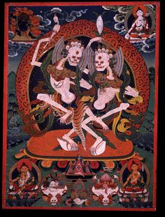 Chitipati. Tibet, Gelugpa,1800-1899 They each have one face with three red glaring eyes and two hands. The Father on the left holds aloft a bone danda with the right hand and in the left a blood filled kapala, wearing a tiger skin, standing on a conch shell. The Mother holds a stalk of grain in the upraised right and a wealth vase in the left, wearing various silks, standing on a cowrie shell. Surrounded by the orange flames of pristine awareness.