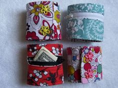 """Wrist Wallet - The only changes I made was using interfacing to back the entire exposed front panel. It adds a little more stability. I also made two button closures on each one rather than the Velcro-it's what I had on hand. I couldn't find any zippers shorter than 12"""", so I just measured how much I needed and stitched back and forth at that point to create the right length. Then, just trimmed off the excess. http://alemonsqueezyhome.blogspot.com/2010/09/lunch-money-cuff-tutorial.html"""