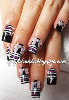 black and pink nails with ribbons