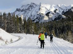 Cross country skiing the Cascade Fire Road in Banff NP