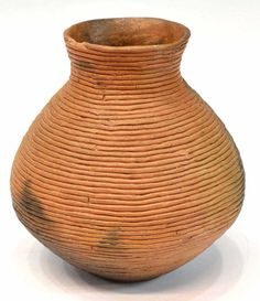 """Southwest Native American pottery coil pot, probably Navajo, the bulbous vessel having a small chip at rim, 8""""h"""