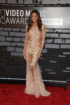 Ciara looked absolutely gorgeous in an embellished, feathered dress by Givenchy Couture.  #VMAs #2013