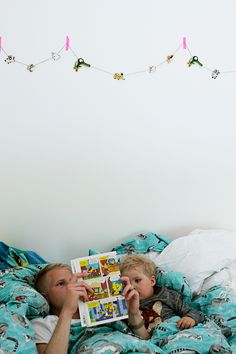 How to make fun DIY garland for a kid's room using pieces from a thrifted board game.