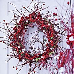 "Simple grapevine wreath covered in red berry ""twigs""."