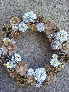 hand cut, hand painted pinecone wreath, made from N.M. pinecones, this wreath has not been sprayed with preservatives or chemicals, measures approximately 60 inches in circumference , 22 inches across , (approximate measures) recommend display in dry area.
