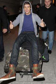Liam Payne he's one of my favorites out of one direction he looks amazing and like he's havering lolts lots of fun✌