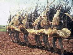 Africa | A month of circumcision, completely healed they dress for dancing (Nchilo) dressed in palm leaf shirts, head and face gear. 'Abakwetha' ~ the circumcision. ceremony of Xhosa, Eastern Cape, South Africa | ©Lister Hunter, ca. 1960s | This is just 1 out of 50 images presenting the whole story of the Abakwetha ~ for those interested the other slides can be viewed by following the link of this pin. {Caution; some graphic content}