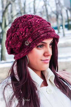 Nollie is a slouchy, extra soft, chunky looking hat, featuring a lacy diamond stitch pattern and a little peek out rolled brim.The pattern includes two hat options, slight difference in gauge and the depth of the hat results in two different styles: a standard slouch newsboy/snowboarder hat and en extra slouchy Jamaican style cap. Both options have a brim decorated with a Button Tab. Both charted and written directions are included in the pattern.Materials: This pattern is suitable for…