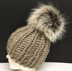 READY TO SHIP items will ship within 24 hours, all others currently taking about 2-3 days. I make every effort to ship sooner. Beige tan super chunky wool beanie womens hat, perfect for the winter! With a huge brown white raccoon fur pom pom!  Pom pom is removable. I knit all hats myself on circular needles and there are absolutely no seams. ~~~ The pom pom can be customized based on your choice. When ordering, please look at the last 2 pictures in the listing and specific a pom pom TYPE…