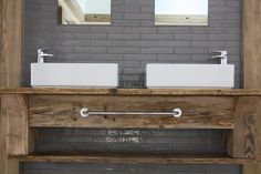 Bespoke sink unit created in master suite with 'his n hers' sinks.  The wood looks amazing!