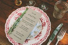 Love the mismatched plates, the menu printed on brown paper, the sprig of rosemary...