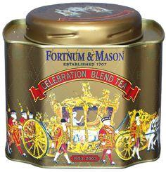 Fortnum & Mason Celebration Blend Tea tea tin, decorated with ornate gilded coach and horses, on gold background, London, UK