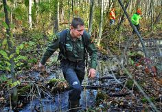 NYS DEC Forest Ranger Jamie Laczco,foreground, leads members of the Lower Adirondack and Northcountry Search and Rescue teams (background) searching a wetland adjacent to the Battenkill Country Club in Greenwich Tuesday afternoon November 13, 2007, for missing 12-year-old Jaliek Rainwalker. (John Carl D'Annibale / Times Union) Photo: John Carl D'Annibale / Albany Times Union