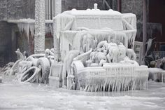 This is the incredible scene in the aftermath of a huge warehouse fire in Chicago after sub-zero temperatures turned water into ice. An Arctic blast had sent temperatures tumbling in the past few days, making it feel like -46C in some areas with the wind chill factor added to the mix. The blaze was one of the biggest the city's fire service has ever had to face and the cold made things even more difficult as icicles formed on fire hoses and froze the firefighters' uniforms.