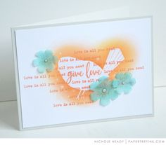 PTI STAMPS: Give Love  INK: Melon Berry, Ocean Tides PAPER: Stamper's Select White, Soft Stone, Vellum Cardstock DIES: Give Love dies OTHER: Filigree Clear Embossing Powder, Copic Marker, Clear Jewels, ink blending tool