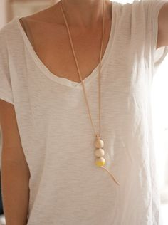 white tee. simple necklace.