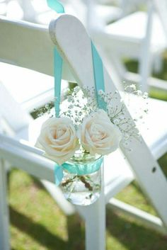 Flowers in hanging ribbon mason jars for seating decor! Love this!