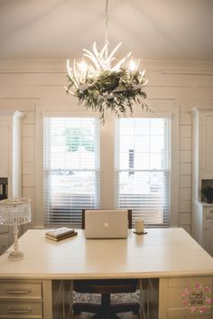 Office area with deer antler chandelier and repurposed cabinets from @simplysoutherncottage.