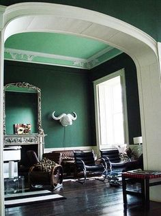 interior decorating with dark green color hues of malachite stone