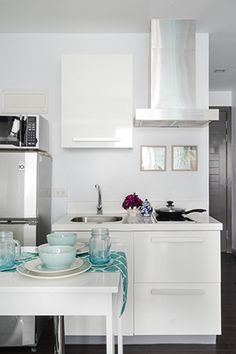 """""""White is an ideal backdrop for the space to make it seem expansive and airy,""""… Studio Condo, Studio Apartment Design, Studio Living, Studio Design, Condo Interior Design, Condo Design, House Design, Tiny Spaces, Small Rooms"""
