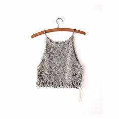 Handknit Organic cotton halter top.Fits slightly loose, cropped just above the waist.Fibre: Organic CottonCare: Hand wash cold, hang dry. Or Dryclean**DUE TO THE HANDMADE NATURE OF THE PIECE, PLEASE ALLOW 10-14 DAYS FOR YOUR ITEM TO BE KNIT.