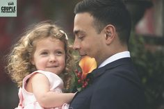 Adorable photo of the groom and his baby daughter. Weddings at Durrow Castle photographed by Couple Photography.