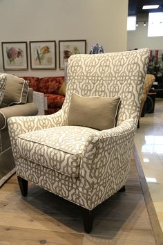 A simple chair design draped in intricately patterned upholstery is the perfect combination for any accent chair! The neutral beige tone keeps the pattern from overpowering the space while still allowing it to make a stunning statement! | Houston TX | Gallery Furniture |