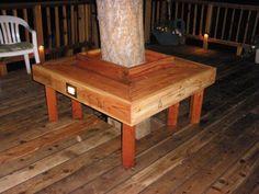 Bench built around tree on deck.