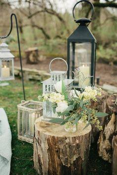 Simple floral and lantern tree stump wedding decor / http://www.deerpearlflowers.com/tree-stumps-wedding-ideas-for-rustic-country-weddings/2/