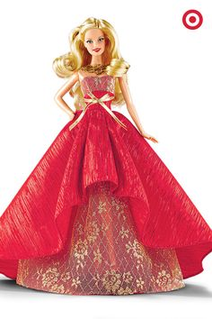 The perfect gift idea for Barbie collectors—the commemorative 2014 Holiday Barbie features a beautiful flowing gown in rich red fabric, accented with an elegant gold bow. Stunning.