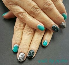 Gel polish manicure on natural nails  Turquoise black and silver with swirl nail art Nails by jackie