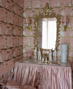 Total pink and gold Chinoiserie insanity vanity (see what I did there?) by, duh, Miles Redd. LOVE the wallpaper, which I can only assume is vintage, the frilly silk vanity skirt, the shades sconces, and the mirrored pink Chinese Chippendale wainscotting. Faaaabulous.