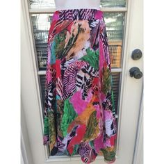 ✨ Vintage colorful patterned reversible tie skirt - This one of a kind piece is stunning and absolutely amazing for any vintage lover! - Very bright patterns and colors throughout (with animal prints!)  - Chiffon feel and lightweight  - AND it's really two skirts, it's reversible! See photo for other side, red and black animal print.  - This is a wrap around skirt meaning it fits any size S-L (you tie it by wrapping it around your body)  - Brand: Vintage  - Size: Tag is S but I am a size L…
