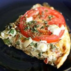 ... frittata topped with fresh herbs, tomato, and Boursin cheese