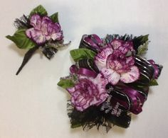 Very pretty and inexpensive: carnation corsage or wristlet.
