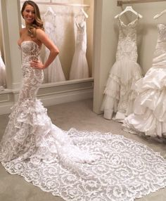 Not sure who the designer is (though this looks like Kleinfeld), but that lace detail is super unique!