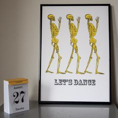 Neon yellow skeleton 'Lets Dance' risograph print. Designed and printed in the UK.Combining Victorian medical illustrations and famous songs.
