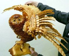 Wooden owl sculpture made from shavings by Sergei Bobkov.