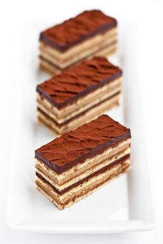 Opéra:    layers of coffee syrup-soaked biscuit, coffee buttercream, Guanaja ganache and Guanaja chocolate glaze.