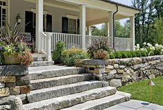 Love the stone wall that butts up to the porch and the stone steps