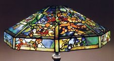 A Tiffany Favrile Glass and Bronze October Night Chandelier, 1899-1918