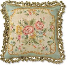Needlepoint tapestry pillow with roses and other floral accents.