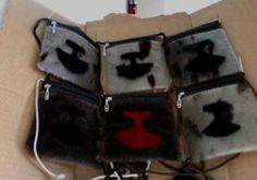 Inuit made sealskin purses by   Eva Kasudluak