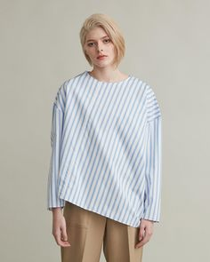 Asymmetric blouse with round neckline, long sleeves and dropped shoulders. Crisp cotton Long sleeves Dropped shoulders Diagonal seam at front and back Loose and boxy cut cotton Model is ft 9 in and is wearing a size S Retail Concepts, Le Moulin, Cool Suits, Apothecary, Designing Women, Blouse, Bell Sleeve Top, Long Sleeve